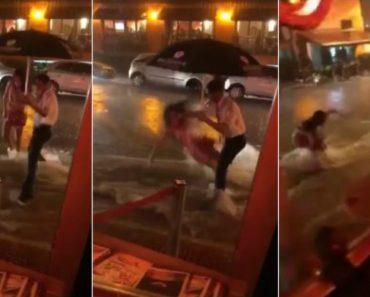 Mulher Cai e é Arrastada Por Enxurrada Em frente De Um Restaurante De Luxo 3