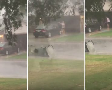 Mulher Decide Lavar o Carro Na Rua Durante Tempestade 7