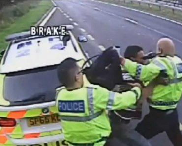Homem Apanhado a Tentar Empurrar Polícia Para Meio Do Trânsito 1