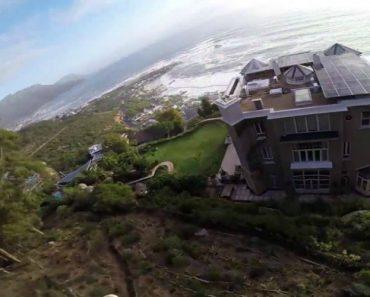 Jovem Filma o Seu Arriscado Salto De Parapente Por Entre As Casas 6