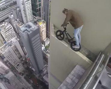 Jovem Arrisca a Vida Ao Andar De Bicicleta No Topo De Um Arranha-Céus 5