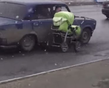 Homem Dentro De Carro é Visto a Arrastar Carrinho De Bebé Em Estrada Movimentada 4