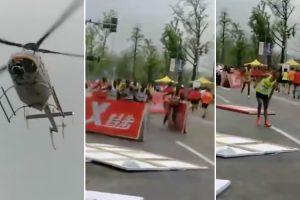 Helicóptero Provoca o Caos Ao Voar Muito Próximo Dos Atletas Durante Uma Maratona 9