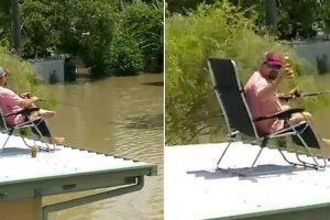 Australiano Aproveita Inundação Para Beber Cerveja e Pescar a Partir Do Telhado Da Sua Casa 10
